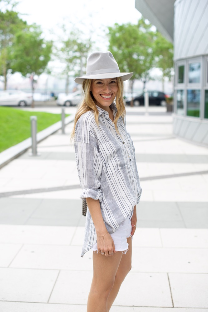 Free People Striped Shirt, Grey Hat, Gold Sneakers, White Shorts