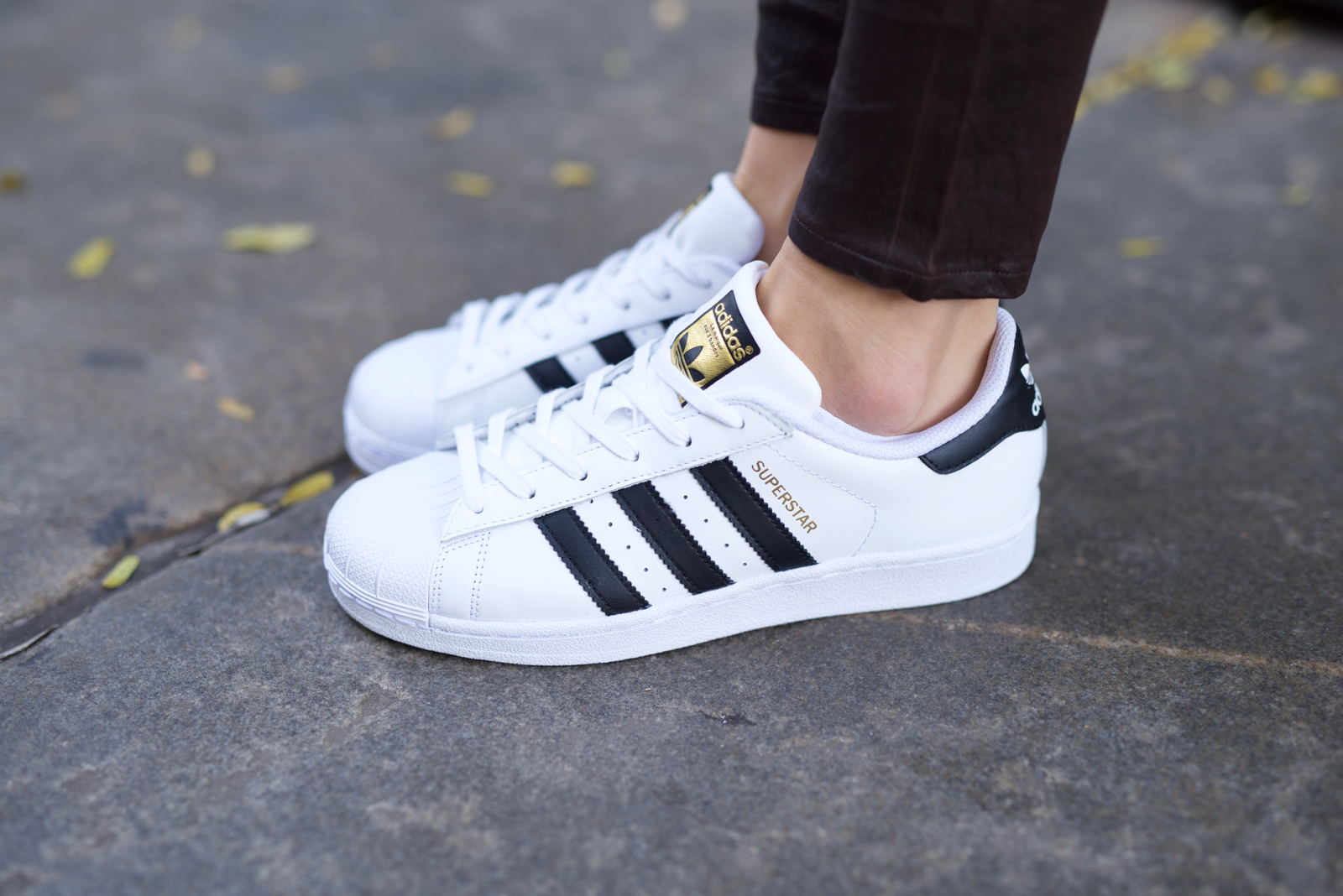 Adidas Superstar shoes, leather pants, cashmere sweater