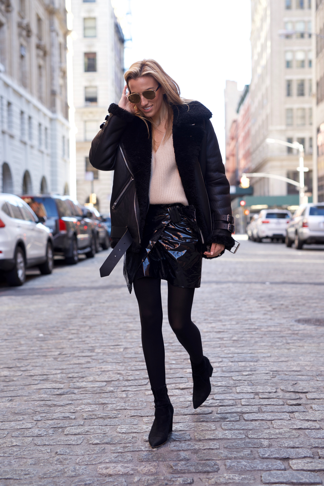 Acne Studios Velocite Coat, Dior Sunglasses, Khaite Sweater, Isabel Marant Patent Leather Mini Skirt, Saint Laurent Bag