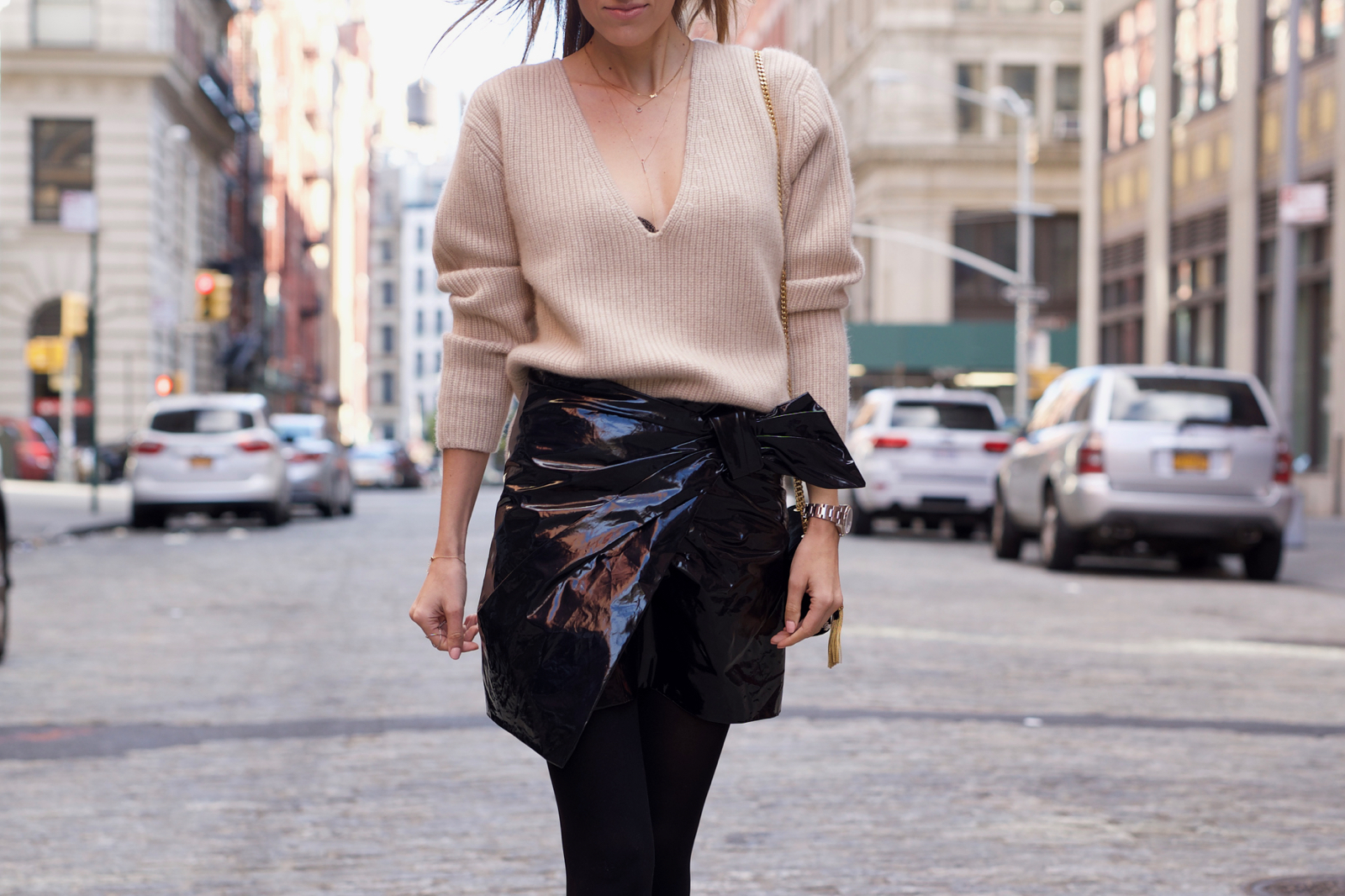 Dior Sunglasses, Khaite Sweater, Isabel Marant Patent Leather Mini Skirt, Saint Laurent Bag, Suede Booties