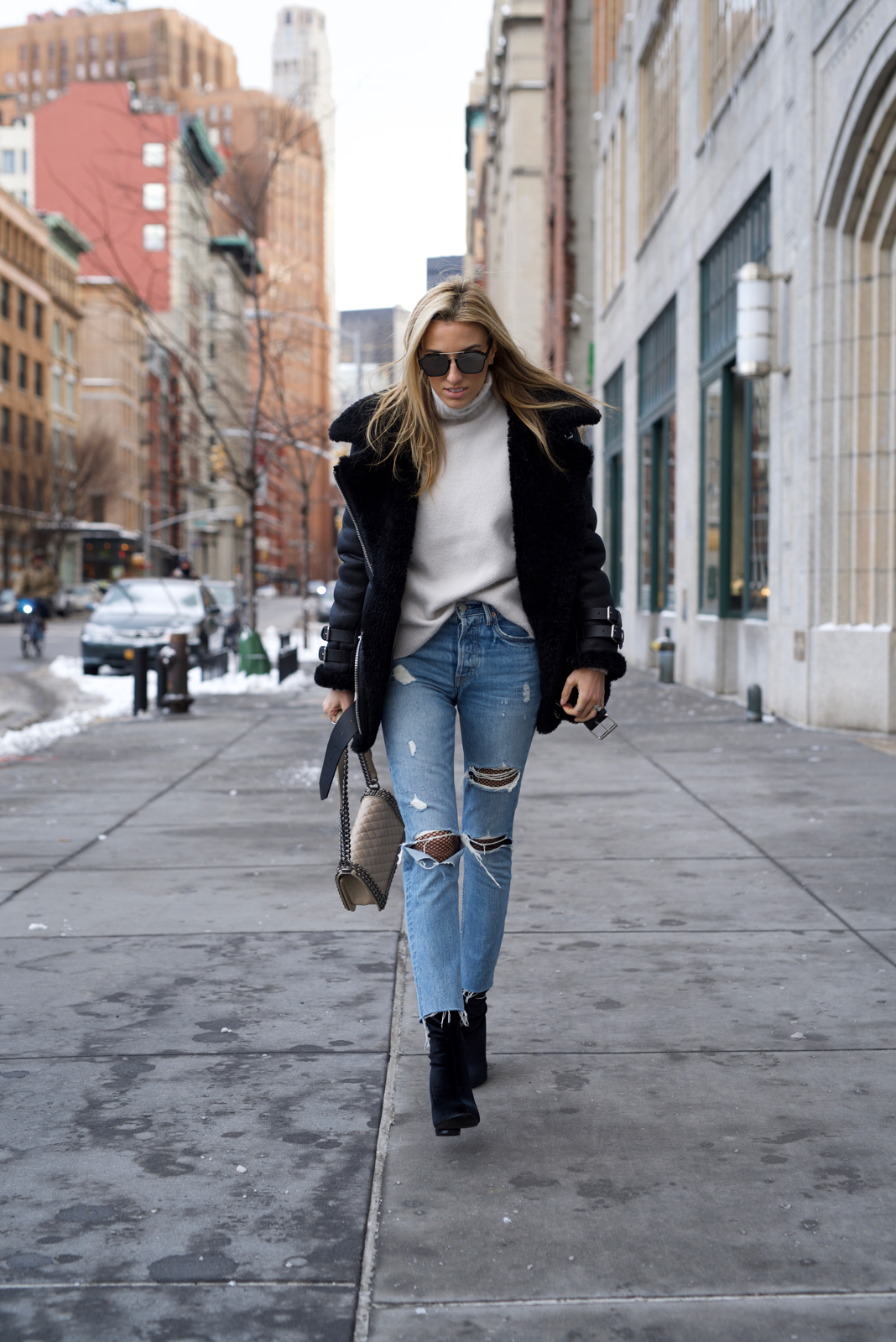 White turtleneck, acne studios coat, Chanel boy bag, velvet boots, Fishnets and ripped jeans trend, Dior sunnies