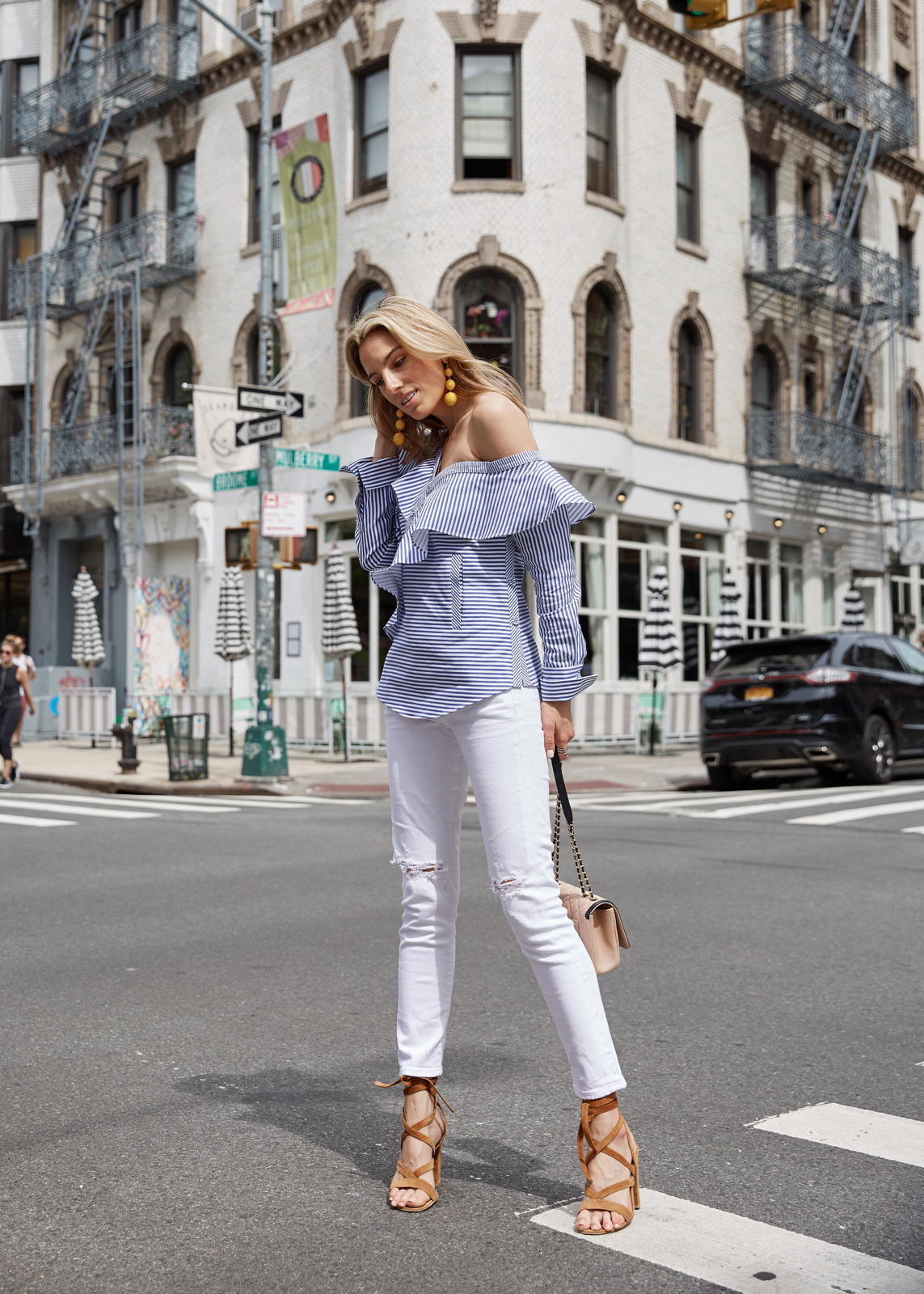 Self-Portrait stripe ruffle top, white jeans, Giavito Rossi Sandals, Yellow earrings, Chanel Bag