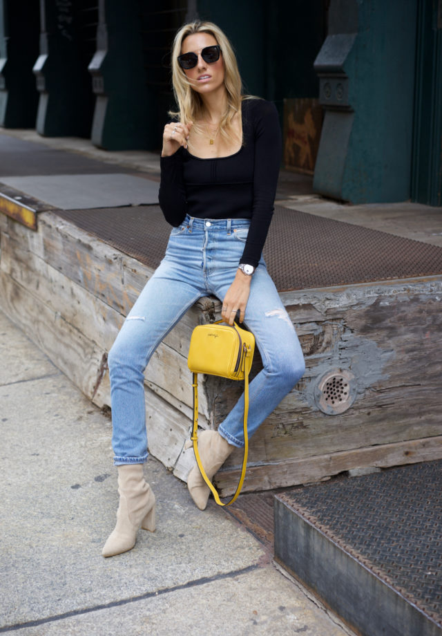 Pop of Yellow, How to Wear This Season's IT Color, Vintage Levi's, Stuart Weitzman Clinger boot, Khaite black top, Celine sunglasses