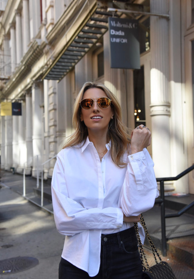 Sunglasses, white boots, color in optics, white shirt, black jeans, NYC street style